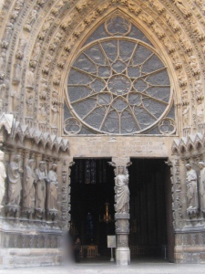 Reims Cathedral - the west portal with rose window and tympanum