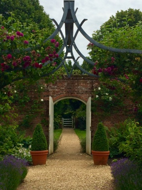 Walled garden at Osborne House, East Cowes, showing V and A initials on trellis
