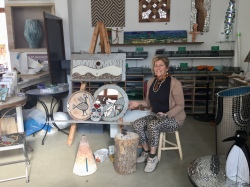 Sharen Taylor in her studio demonstrating how to cut tesserae