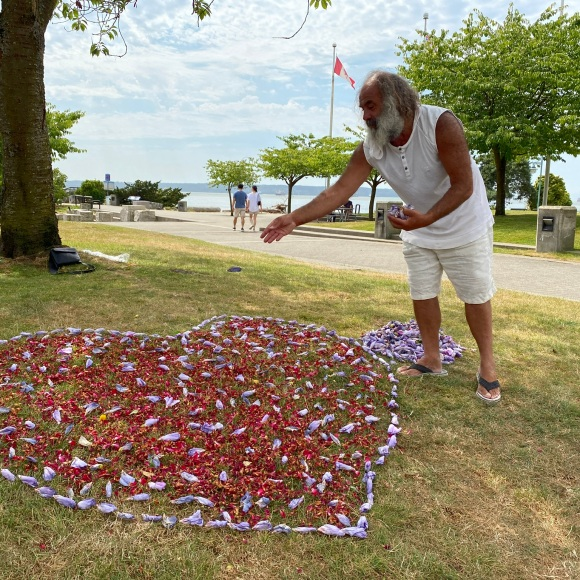 The Heartman creates an inspiring flower heart. Photographed with his permission.